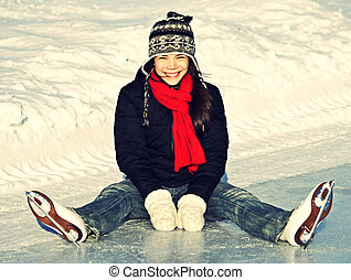 Ice skating fun outdoors - Ice skating woman sitting on the...