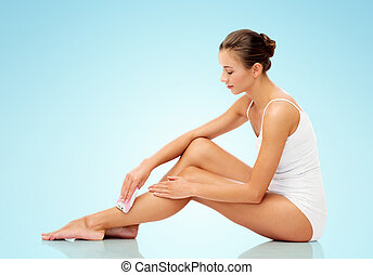 woman with epilator removing hair on legs - people, beauty...