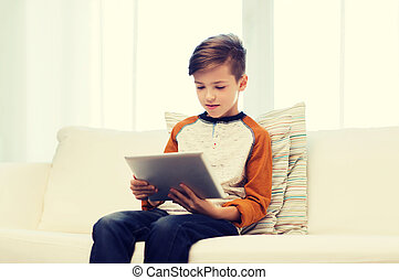 boy with tablet computer at home