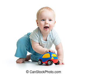 Baby boy playing with car toy isolated on white