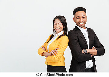 Happy colleagues business team standing over white background