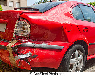Damaged tail and side of a car