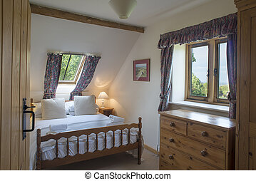 Fully-Furnished Vacation Cottage Attic Bedroom with Skylight
