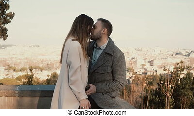 Young couple met at place with panorama view. Man and woman...