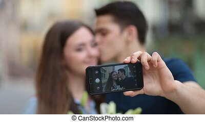 Loving couple on holiday making selfie on phone - Cheerful...