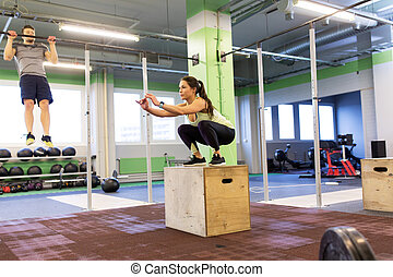 woman and man exercising in gym