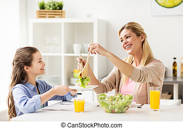 happy family eating salad at home kitchen - healthy eating,...