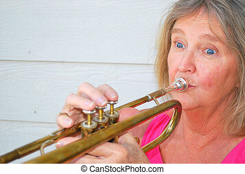 Female jazz trumpet player. - Mature female jazz trumpet...