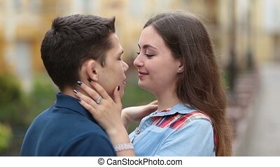 Cheerful young couple in love smiling outdoors - Loving...