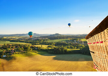 Basket view from hot air balloon, flying above rural...