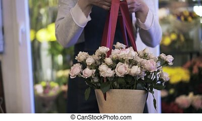 Florist woman enjoying the results of her work front view