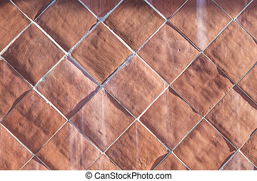 background of harmonic cotto tiles in red - pattern of...
