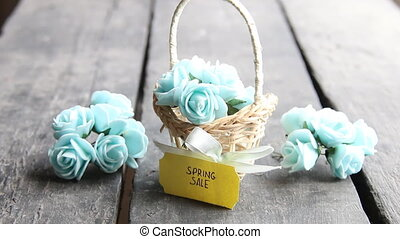 spring sale - creative idea, tag and flowers in a small basket