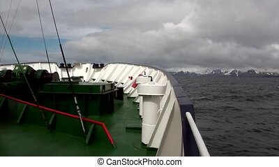 Cargo ship on background of snow mountains of Ushuaia Argentina.