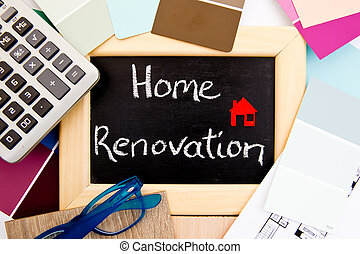 Home Renovation handwritten on blackboard with calculator,...