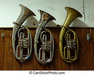 old baritone horns - three old baritone horns hanging on the...