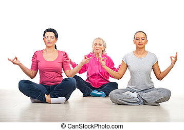 Group of women in yoga position - Group of three women in...