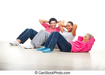 Happy women doing abs - Laughing happy women having fun and...