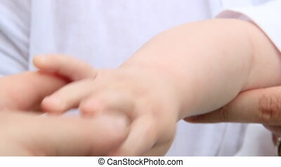 Closeup of father hand holds his baby hand - Newborn baby...