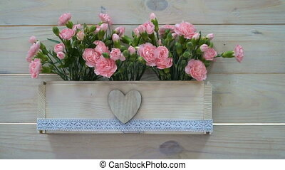 Wedding decor of flowers in a pot in rustic style.