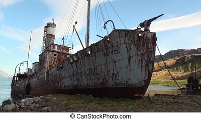Destroyed rusty whaling ship and mountains of Falkland...