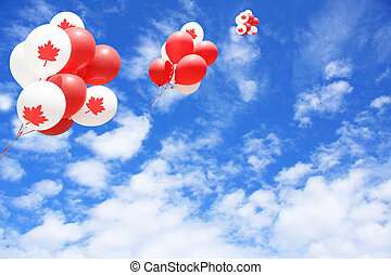 Canada day - Canadian maple leaf flag balloons in the sky...