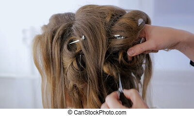 Hairdresser finishing hairstyle for client - Hairstylist,...