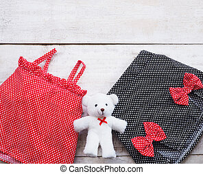 summer dress of girl kids and teddy bear doll