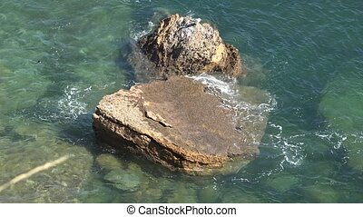 Rock Formation In Shallow Ocean Water