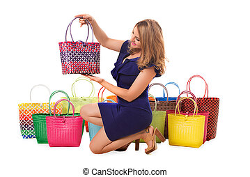 Happy woman in blue dress with bright tote bags.Isolated.