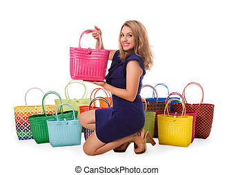 Beautiful woman in blue dress with bright tote bags.Isolated.