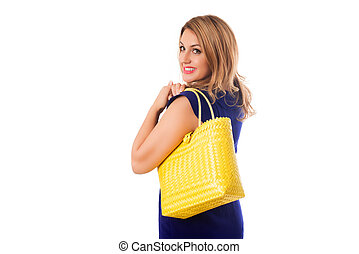 Closeup woman in blue dress with bright tote bag.Isolated.