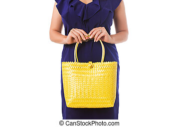 Closeup woman in blue dress with yellow  tote bag.Isolated.