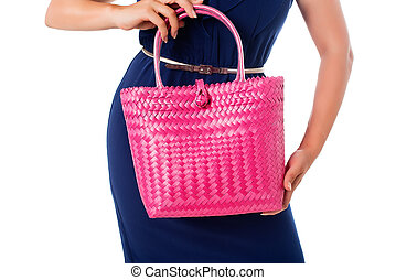Closeup woman in blue dress with magenta  tote bag.Isolated.