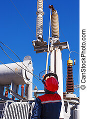 The duty electrician of substation makes switchings -...