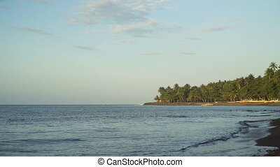 Beach on tropical island. - Beach with black volcanic...