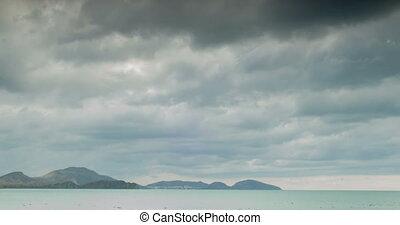 Overcast sky over the sea and far away coast. timelapse