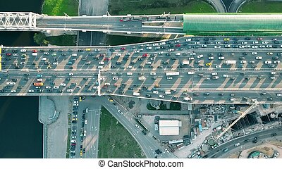 Aerial top down shot of heavy congested road traffic and...