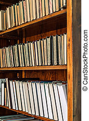 old books on an archival shelf of library. - old books on an...