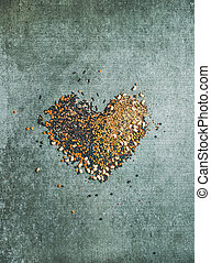 Variety of raw grains, beans, cereals in shape of heart