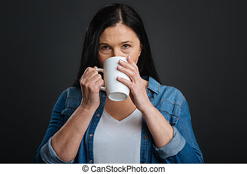 Elegant gorgeous woman enjoying hot drink