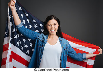 Optimistic confident woman being very patriotic