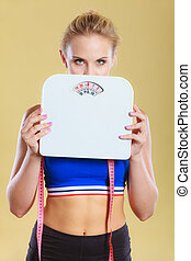 Frustrated woman unhappy with weight gain