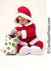 Baby Opening Present at First Christmas.