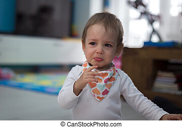girl at home crying - Small cute little girl at home crying...