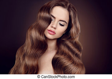 Beauty hair. Brunette girl with long shiny wavy hair....