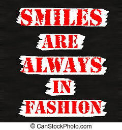 Smiles are always in fashion.Creative Inspiring Motivation Quote Concept Red Word On Black wood Background.