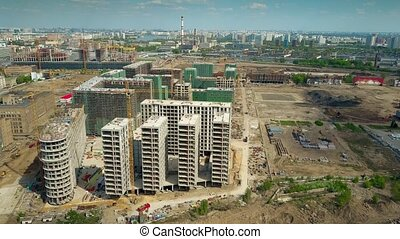 Aerial of modern apartment buildings construction site -...