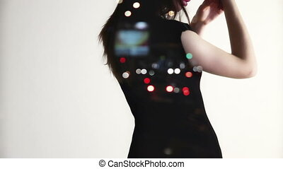 dancing woman on white background and with city lights on...