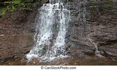 Spring Rusyliv cascading waterfall - Small waterfall on...